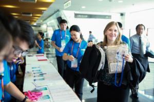 Ellen collecting her conference pack during registration
